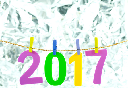 New Year 2017 number on blond background.
