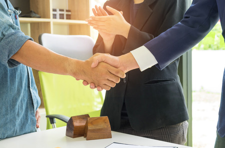 Concept home purchase contract,Home sales with customers hand in hand after the deal,Business people join hands with customers after the deal.