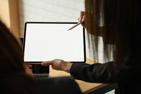 Team businesswoman working on blank screen modern tablet in office.