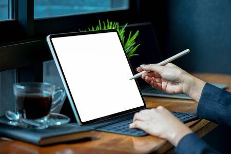 Businesswoman working on blank screen modern tablet in office.