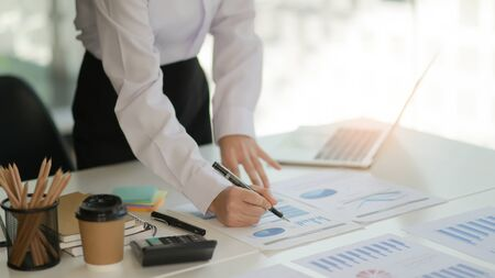 The auditor is analyzing the data graph of the organization in a modern office.