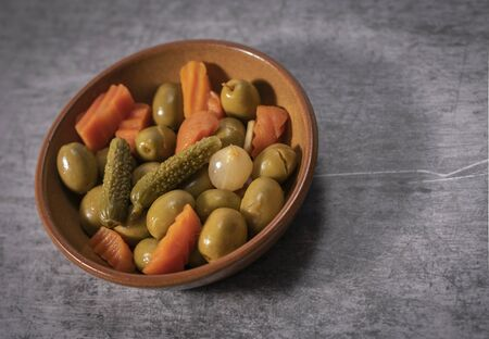 Pickles, carrots and olives in a bowl