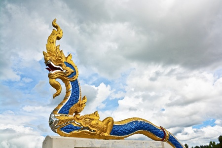 Naga statue with cloud in the sky, Thailand  Stock Photo