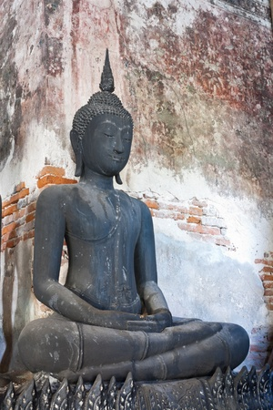 black Buddha  wall of the old Wat Suthat Thailand