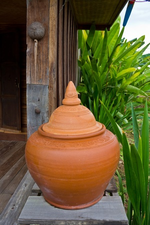 A clay pot of water.