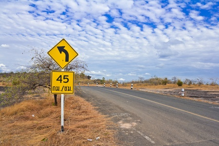 Yellow Curve Warning Road Stock Photo