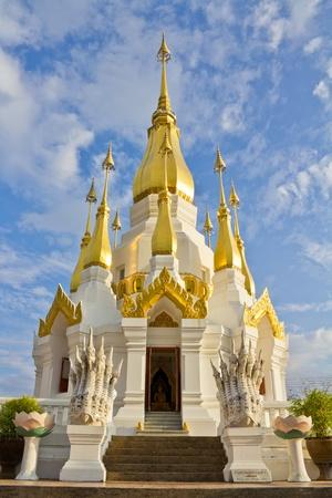 Golden pagoda in the temple of Ubon Ratchathanee, Thailand Stock Photo