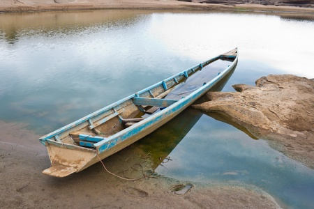 Old wooden boat along the lake shore.