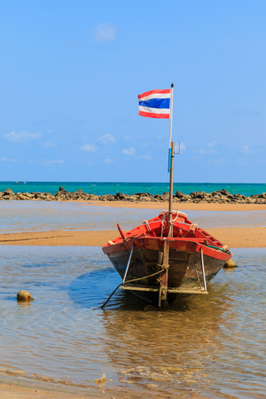 Fishing boat moored along the beach,Thailand photo