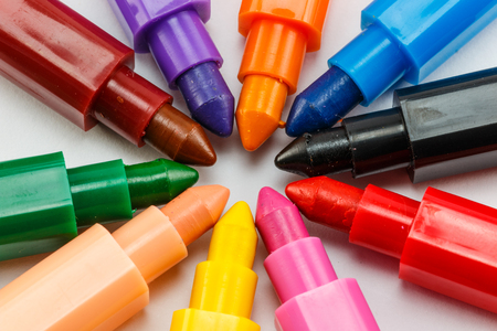 colourful crayons on white background photo