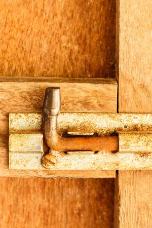 old steel Bolt on wood door photo