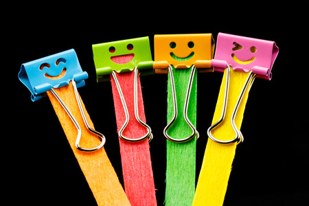 close up colorful of binder clips on Ice cream sticks photo