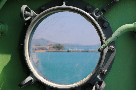 Steel porthole of warship photo