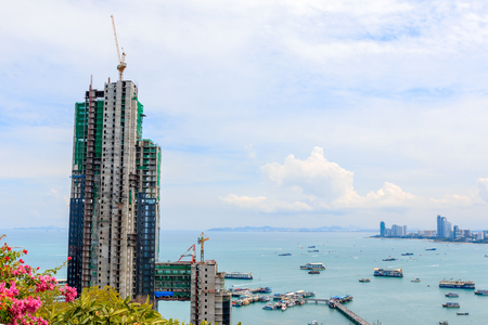 objections: PATTAYA - AUGUST 23, 2014: The new building site name is Water Front Suites &a mp ; Residence Pattaya , Building Obscured the view Pratamnak Hill. August 23, 2014 in Pattaya,Thailand. Pattaya Mayor suspended! Building Obscured the view Pratamnak Hill .