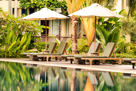 Luxurious swimming pool in a tropical garden, Thailand. photo