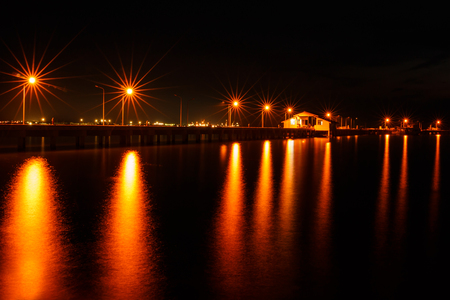 behind scenes: Small port ship and reflect lamp in night time