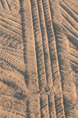 Tire tracks on the sand photo
