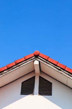 gable house: Gable of a House on blue sky background