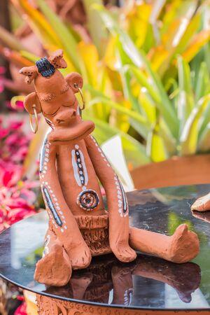 barbarian: Sleeping Barbarian Clay Dolls sitting on table in garden