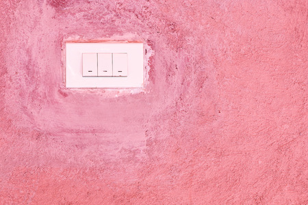 concrete background: Old Switch on pink cement wall Stock Photo