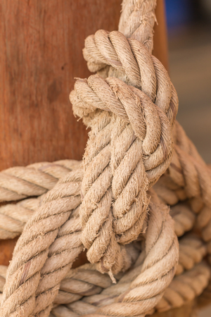 tied knot: Old fishing boat rope with a Tied Knot