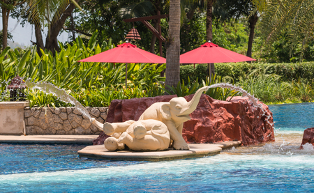 thai spa: Elephant Water fountain and luxury Outdoor Swimming Pool at a Thai Spa Resort