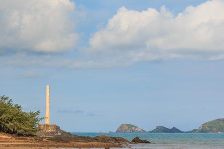 cement pole: Big cement pole standing near the sea