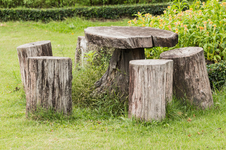 timber bench seat: Big seat chairs made of wood trunk in garden