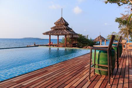 gazebo: Gazebo wood and swiming pool near sea Stock Photo