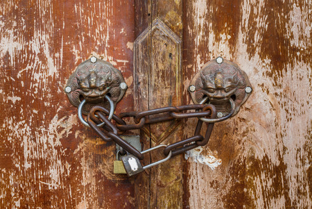 Lion Head Door Knocker, Ancient Knocker with chain and lock photo