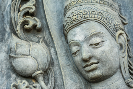 temple thailand: close up face of statue on the wall in temple , Thailand