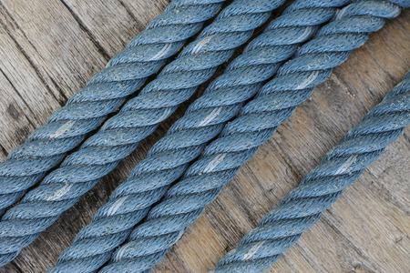 twine: Blue nylon twine is old Rope on wood background