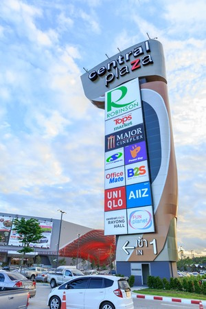 newest: RAYONG, THAILAND – JUNE 21, 2015 : Central Plaza logo on blue sky and cloud at new Central Plaza  Shopping mall , It is the newest Shopping mall in Rayong  Thailand . June 21, 2015