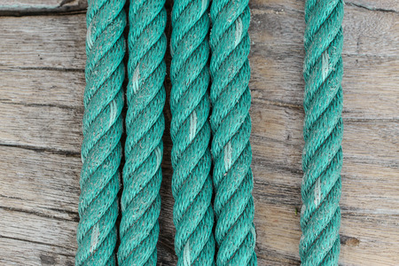 twine: Green nylon twine is old Rope on wood background Stock Photo