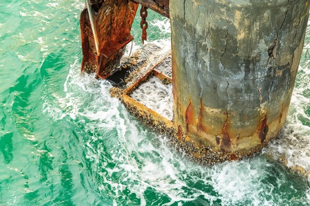 sea seaport: dilapidated seaport against strong sea wave