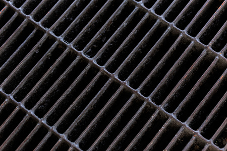 grate: Close up Sewer grate and slop oil