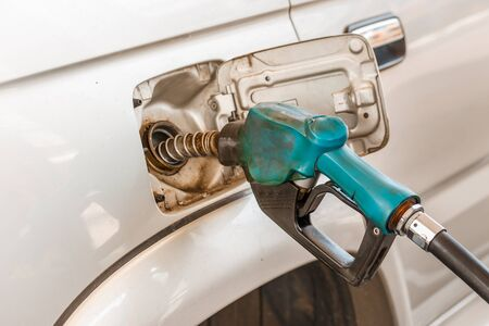 fueling pump: Closeup of pumping gasoline fuel into car tank