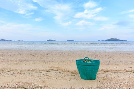 waste basket: Green Waste basket on the beach