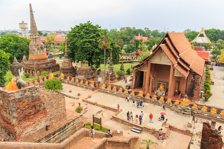 tourisms: AYUTTHAYA, THAILAND- AUGUST 8 : The tourisms are going up into big pagoda in Wat Yaichaimongkol Buddhist temple in the city of Ayutthaya Historical Park at Ayutthaya,Thailand August 8, 2015