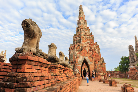 tourisms: AYUTTHAYA, THAILAND- AUGUST 7: The broken Buddha statues and tourisms  in Wat Chaiwatthanaram  Buddhist temple in the city of Ayutthaya Historical Park at Ayutthaya,Thailand August 7, 2015 Stock Photo