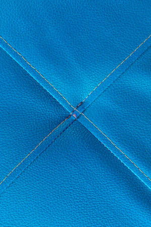 crosswise: Blue leather with stitch texture and crosswise  symbol Stock Photo