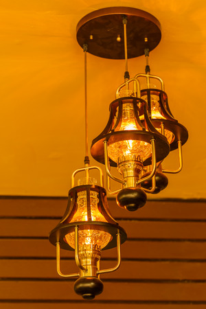 pomp: Yellow lamps with glass structure on ceiling in ballroom
