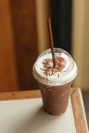 creamed: Iced cocoa glass with Straw Stock Photo