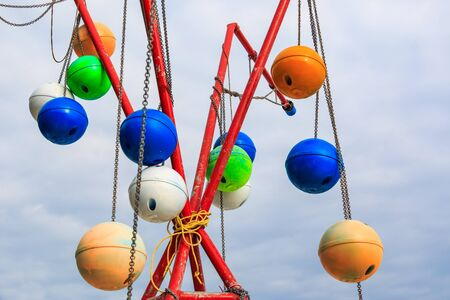 samet: SAMET RAYONG , THAILAND – AUGUST 25 , 2015  : The old fishing buoy hanging with chain for decorate in Samet island in Rayong , Thailand on August 25, 2015