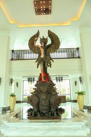 nakhon pathom: NAKHON PATHOM , THAILAND -  AUGUST 27,2015 : The big bronze statue at Mida Dhavaravati Grande Hotel in Nakhon Pathom in Thailand on August 27,2015