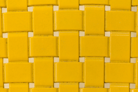 checkered background: old Yellow Placemat, texture Stock Photo