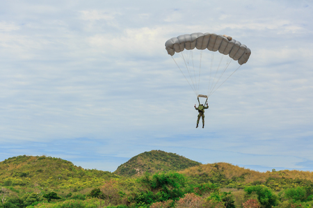 descends: Parachutist descends and trains in landing accuracy that parachute fly over mountai Stock Photo