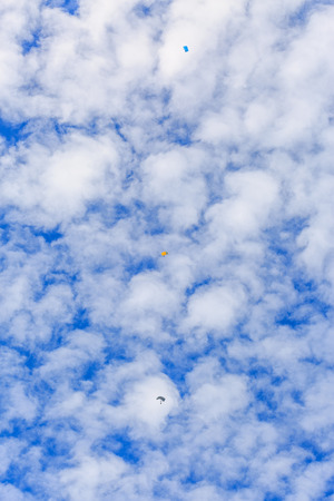 descends: The parachutist descends and trains in landing accuracy that parachute fly on blue sky