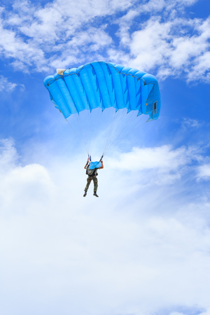 descends: SATTAHIP , THAILAND - SEPTEMBER 23 , 2015 : The parachutist descends and trains in landing accuracy that parachute fly on blue sky with white cloud in day in Sattahip ,  Thailand on September 23 ,2015 Editorial