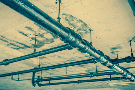 tuberias de agua: Old water pipes under  roof